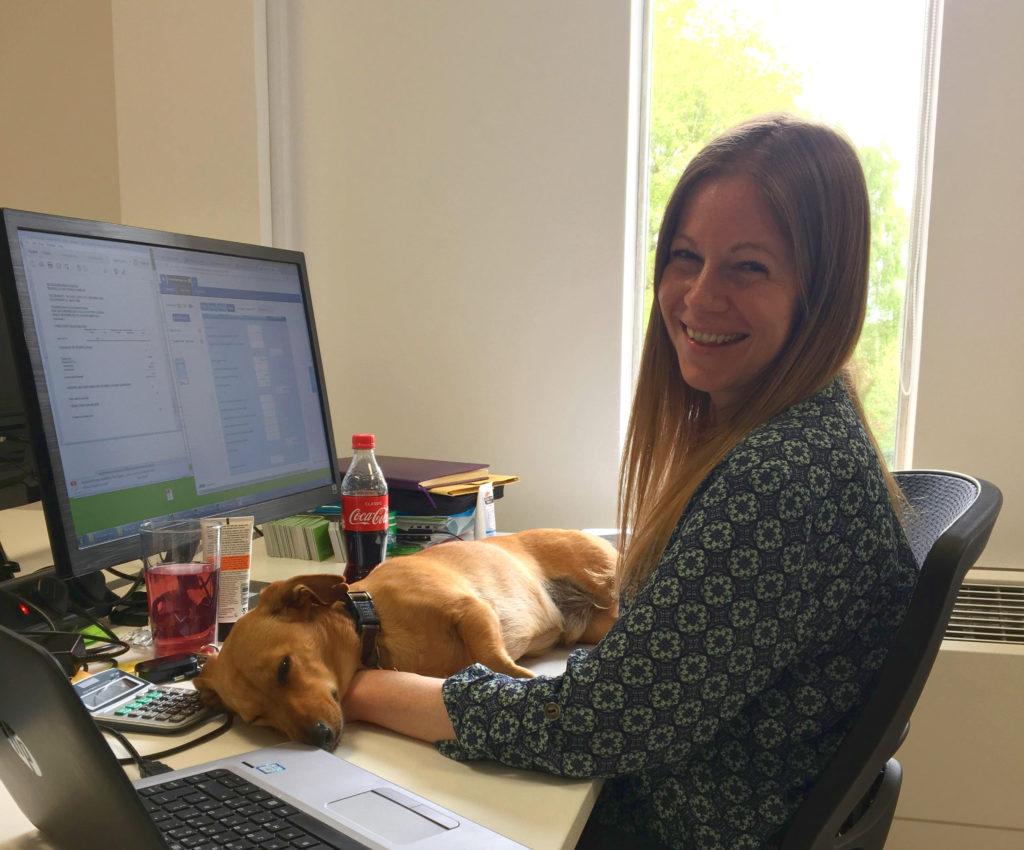 Kelly Oakley in the office with Alfie