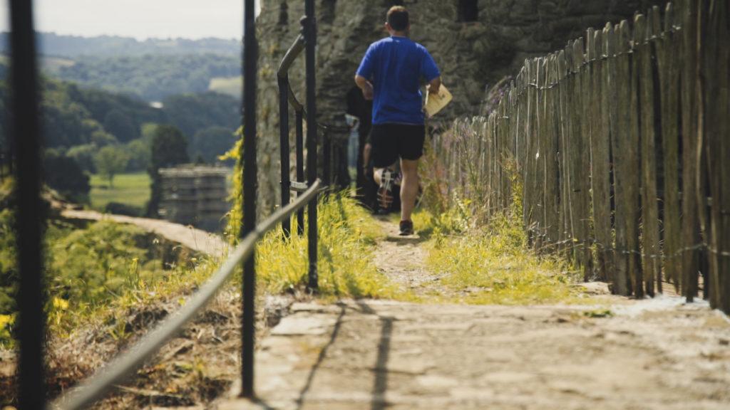 Man running along castle walls