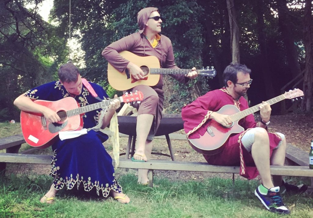 Three guitarists in medieval dress