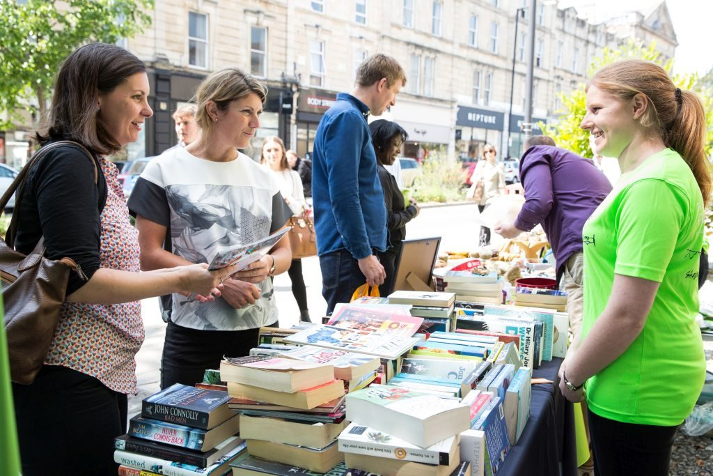 People buying books at charity book sale