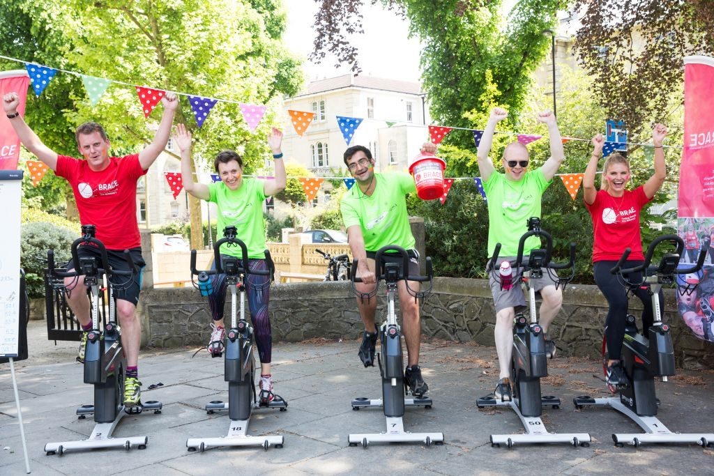 Team racing on spin bikes for charity